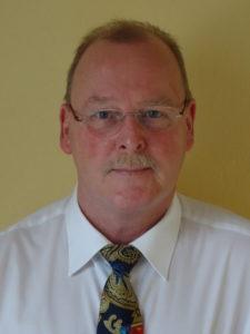 Betriebsarzt Georg Arends, seit 1996 betreut er erfolgreich Klein- und mittelständische Unternehmen in der Arbeits- und Betriebsmedizin
